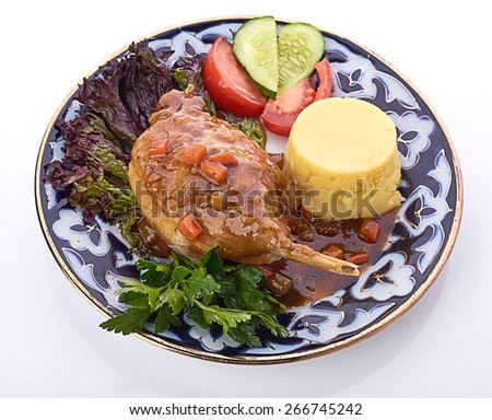 Roasted duck leg with red cabbage