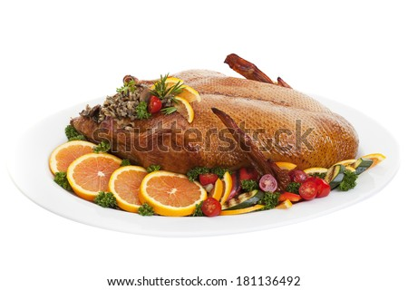 Roasted duck on a plate with salads oranges and vegetables,on a white background. - stock photo