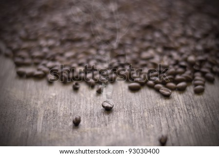 Roasted Ethiopia Highland coffee pearl beans on old and weathered wood. - stock photo