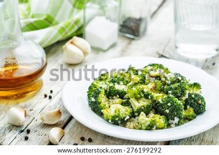 roasted garlic broccoli quinoa salad. the toning. selective focus - stock photo