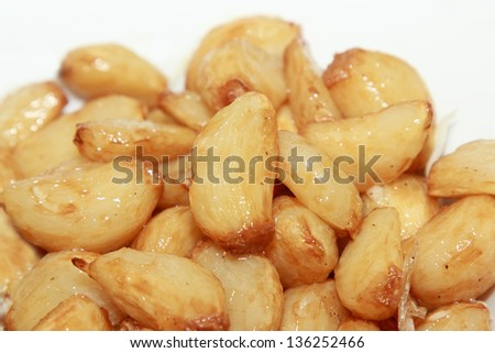 roasted garlic with butter and herb - stock photo