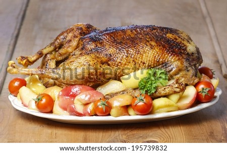 Roasted goose on wooden table - stock photo