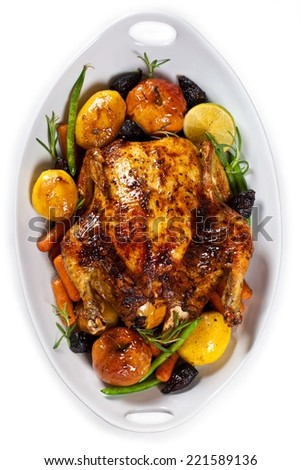 Roasted Holiday Chicken With Potatoes and Apples. Isolated on White Background. - stock photo