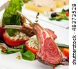 Roasted Lamb Chops with Pistachio. Garnished with Vegetables and Basil - stock photo