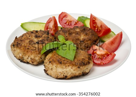 Roasted meat cutlets with tomatoes and cucumbers on the white  plate isolated. - stock photo