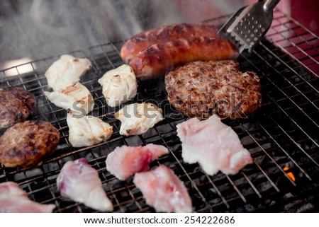 Roasted meat on the grill. Barbecue. Restaurant - stock photo