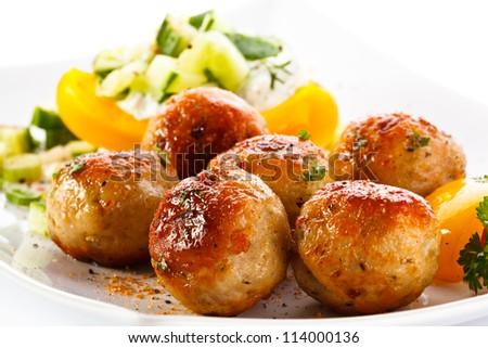Roasted meatballs and vegetable salad - stock photo