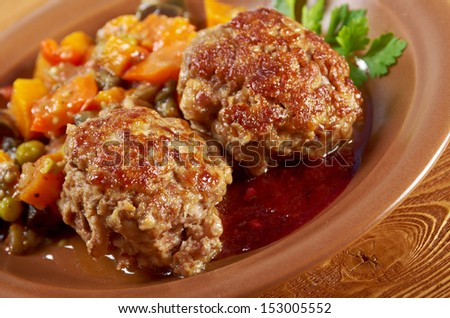 roasted meatballs beef with vegetables on a plate