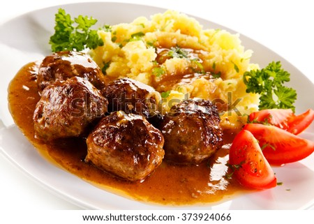 Roasted meatballs, mashed potatoes and vegetables  - stock photo