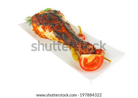 roasted pasted chicken drumstick on white with fennel - stock photo