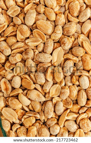 Roasted peanuts in closeup on the white background - stock photo