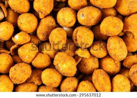 Roasted Peanuts with crispy and  maize coating. - stock photo