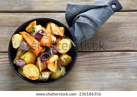 roasted pieces of vegetables in pan, food - stock photo