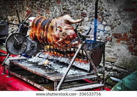 roasted pig on the gridiron - stock photo