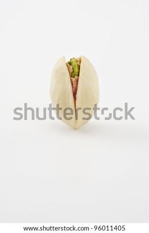 Roasted pistachio on white - stock photo