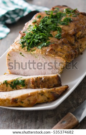 Roasted pork on wooden table