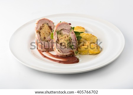 Roasted pork roll stuffed with rice and  potatoes with cheese - stock photo