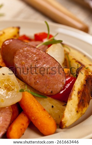 Roasted Potato and Sausage Dinner. Macro. Selective focus. Shallow DOF. - stock photo