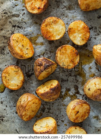 Roasted Potatoes. Selective Focus. Shallow Depth of Field. - stock photo