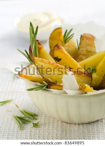 Roasted potatoes with herbs in bowl. Selective focus - stock photo