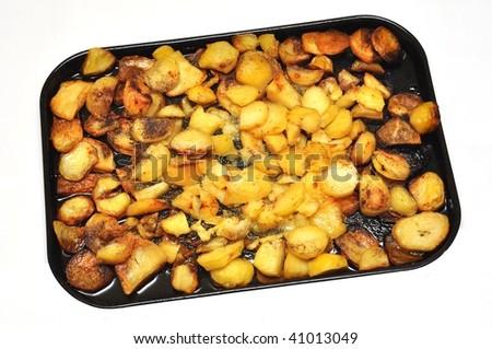 Roasted potatoes with rosemary  isolated on white - stock photo