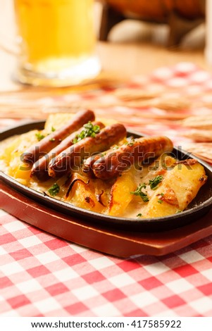 roasted potatoes with sausage in the bar - stock photo