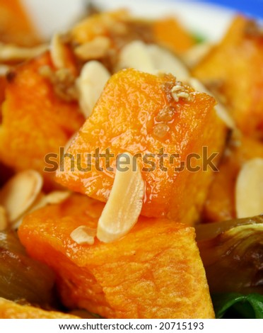 Roasted pumpkin and onion salad with wilted spinach and toasted almonds. - stock photo
