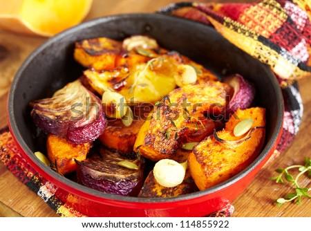 Roasted pumpkin with onion and lemon - stock photo