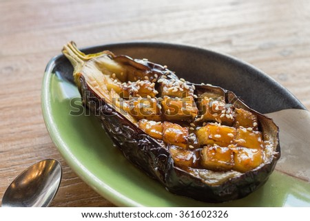 Roasted purple eggplant with japanese miso sauce - stock photo