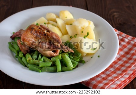 Roasted quail with potatoes and green beans - stock photo