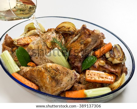 Roasted rabbit with herbs, vegetables and white wine sauce - stock photo
