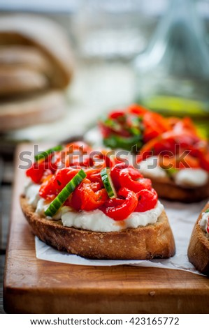 Roasted Red Sweet Pepper, Cucumber and Feta Bruschetta, copy space for your text