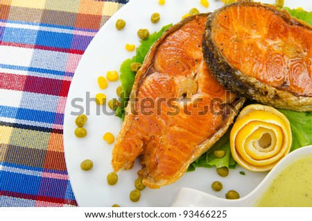 Roasted salmon in the plate - stock photo