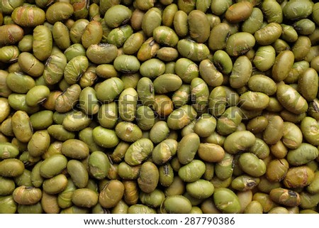 Roasted salted soy nuts as an abstract background texture - stock photo