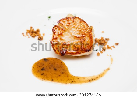 roasted scallop with truffle sauce - stock photo
