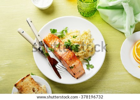 roasted steak salmon on plate, food top view - stock photo