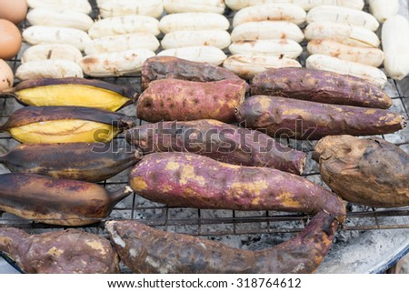 roasted sweet potatoes at street food in thailand - stock photo
