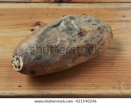 Roasted sweet potatoes on wooden table - stock photo