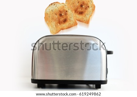 Roasted toast bread popping up of stainless steel toaster