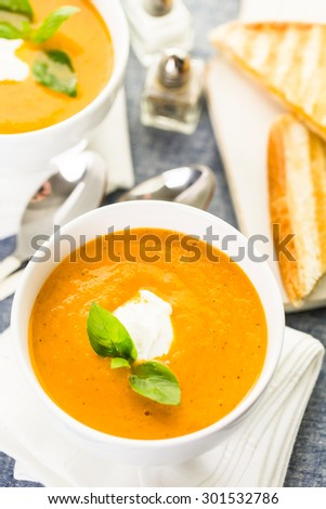 Roasted tomato soup cooked with organic heirloom tomatoes and served with grilled cheese sandwich.