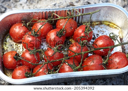 Roasted tomatoes with olive oil on a grill