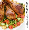 Roasted turkey legs with vegetables. - stock photo