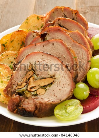 Roasted turkey roulade with potatoes, beet and grapes. Shallow dof. - stock photo