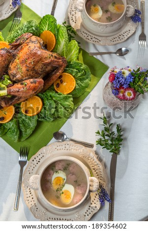 Roasted turkey served with sour soup on spring dinner - stock photo