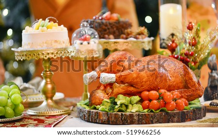 Roasted Turkey.Table served with turkey in Christmas dinner, decorated with candles.