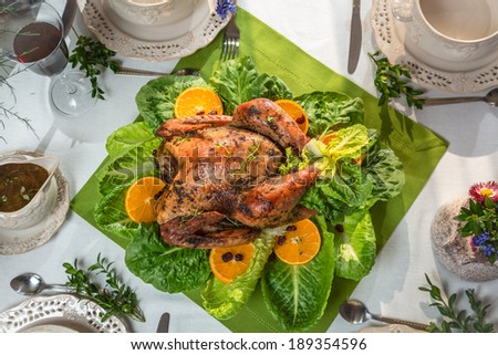 Roasted turkey with orange and served on lettuce - stock photo
