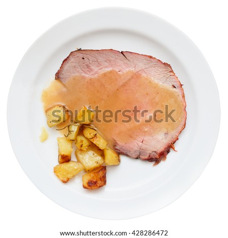 Roasted veal fillet with fried potatoes, isolated on white - stock photo