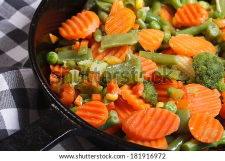 roasted vegetables in a frying pan. horizontal. close up. macro  - stock photo