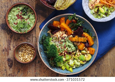 Roasted vegetables with pesto and humus - stock photo