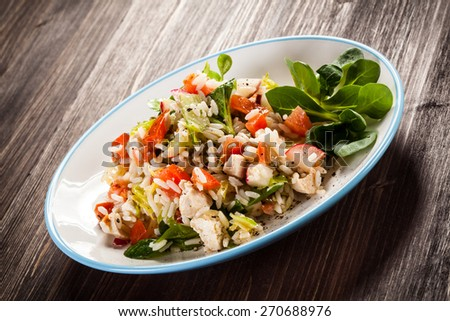 Roasted white meat, rice and vegetables - stock photo